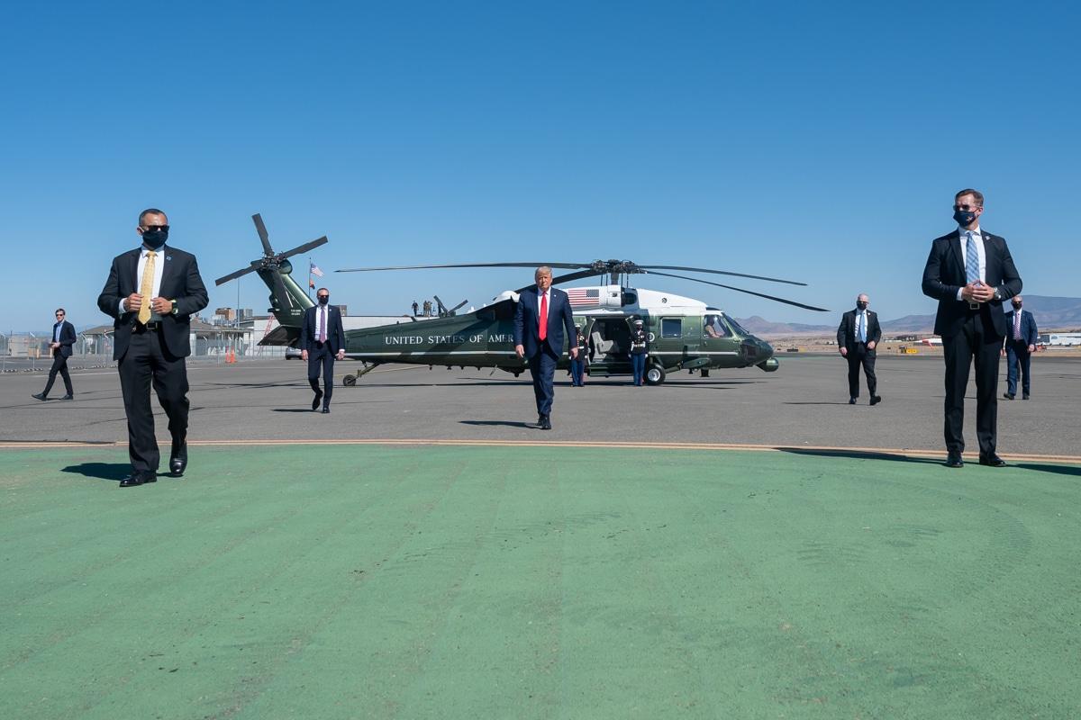 President-Donald-J.-Trump-walks-across-the-tarmac-after-disembarking-from-Marine-One-Public-Domain